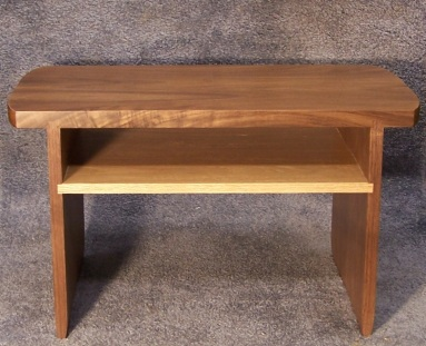 Completed Puja Table! Walnut is the primary species, with red oak shelf for a contrasting color, inserted into dados in the leg pieces.