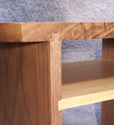 """One side's sliding dovetail. They are visible on both sides. I relieved some material in the middle to create less friction as they were being put into place. See Episode 2 """"The Dove's Long Tale"""" for more info."""