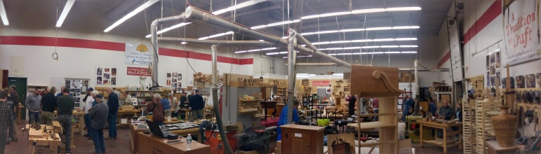 """Thanks to Google+ """"auto-awesome"""", a panoramic of Connecticut Valley School of Woodworking. Lie-Nielsen area is on the left, and other vendor booths along back wall."""